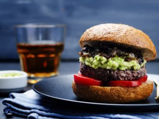 black-bean-burger-with-mashed-avocado--caramelized-onions-and-tomatoes-589977718-5ab84dcc30371300371106af.jpg